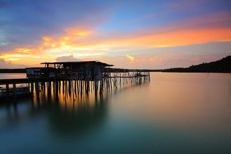 Wooden House In Body Of Water During Sunset Photo Free Public Domain Cc0 Image