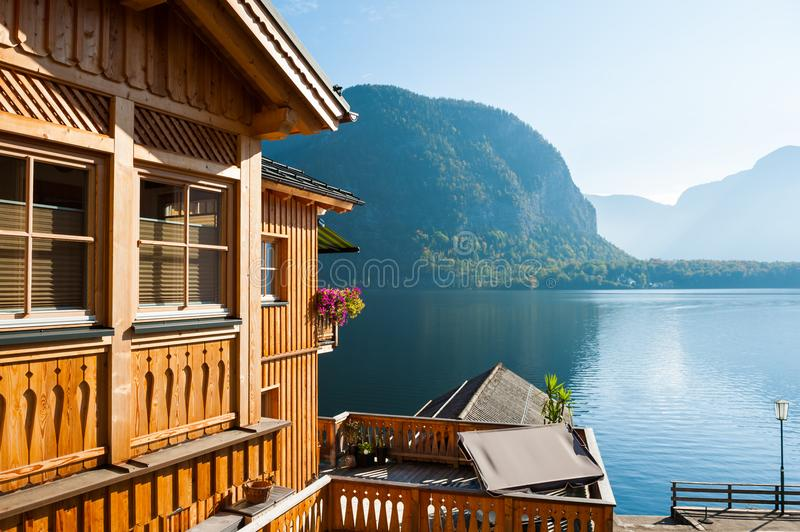 Wooden house on the coast of lake royalty free stock photos