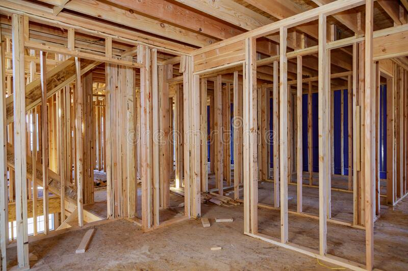 Wooden house construction home framing interior residential home. Wooden beam house construction home framing interior residential home royalty free stock images