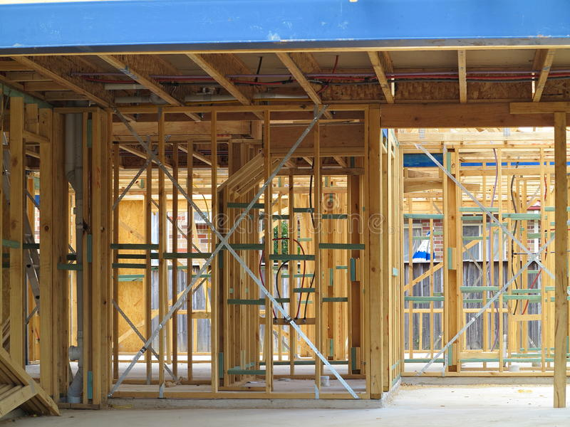 Wooden house construction inside. Framing stage of a family home in an Australian suburb, Sydney - view from inside stock photography
