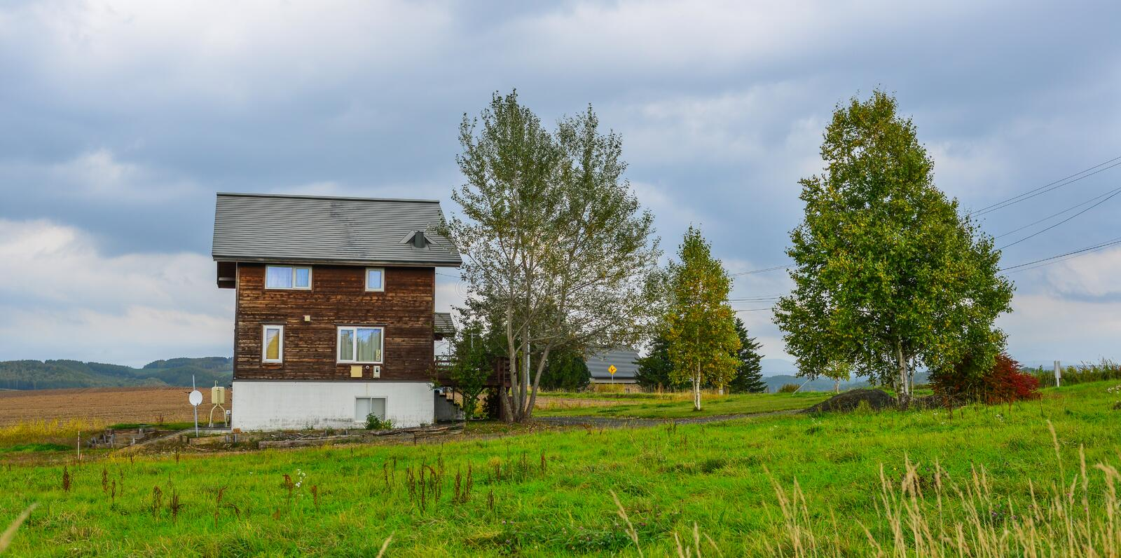 A wooden house at countryside stock images