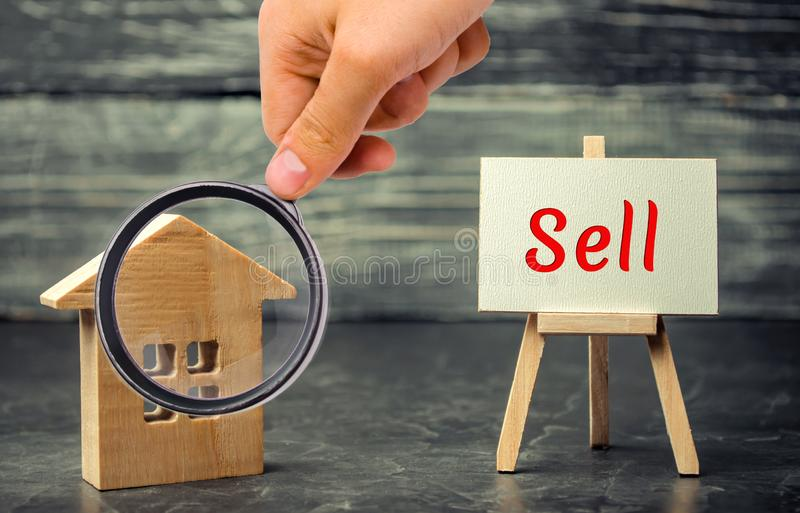 Wooden house and dollars with the inscription sell. sale of property, home. affordable housing. sale of apartments. real estate ag. Ent services. realtor stock photography