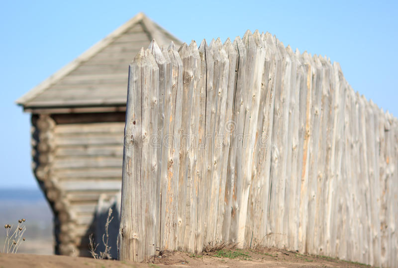 Wooden house and fence stock photo