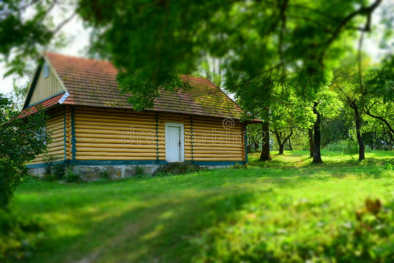 Wooden house by the garden stock images