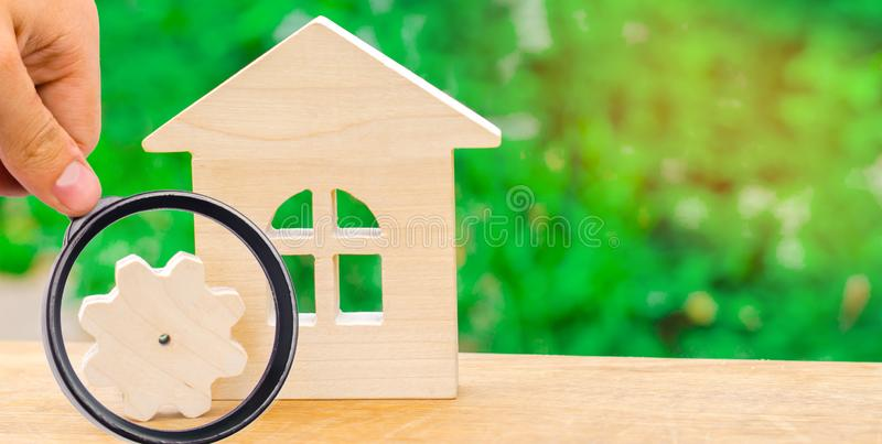 Wooden house and gear. Concept of project development. Energy efficiency at home, new technologies and innovations. Industrial co royalty free stock image