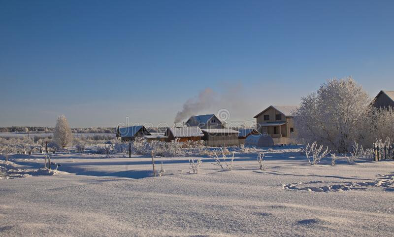 The wooden house with the household.buildings winter frosty day stock images
