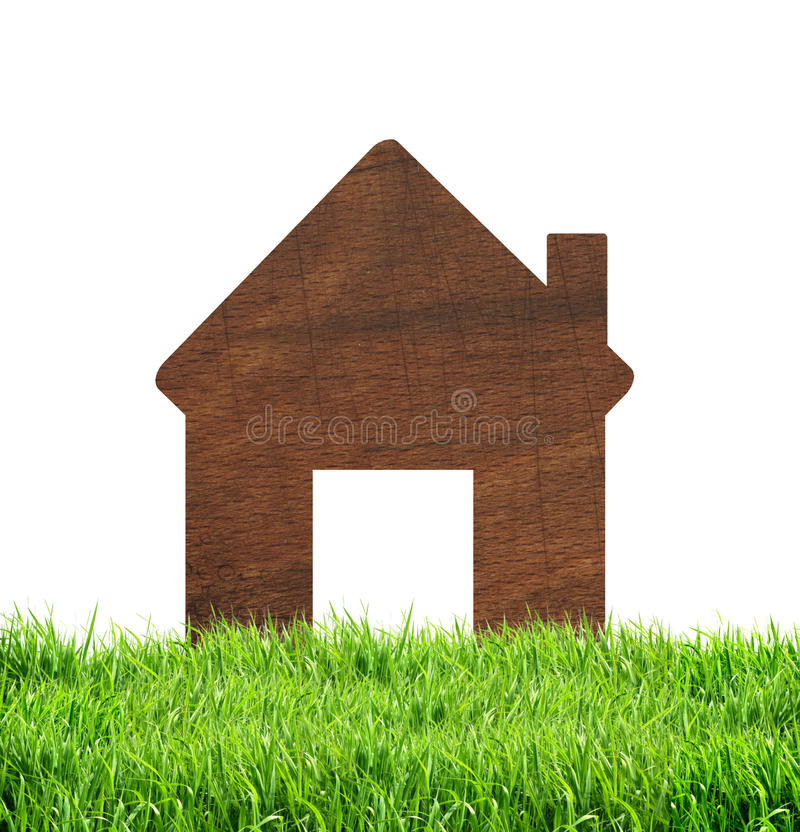 Wooden house icon on green grass isolated on white background. Wooden house icon on green grass isolated on the white background royalty free stock photo