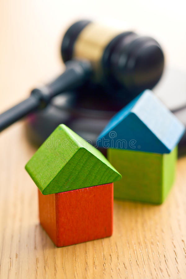 Wooden house and judge gavel stock photos