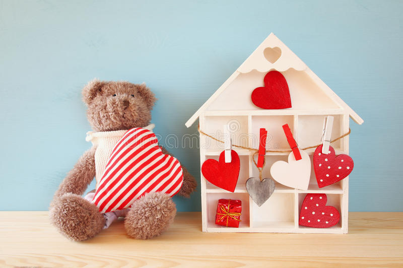 Download Wooden House With Many Hearts And Cute Teddy Bear Stock Image - Image: 83701699