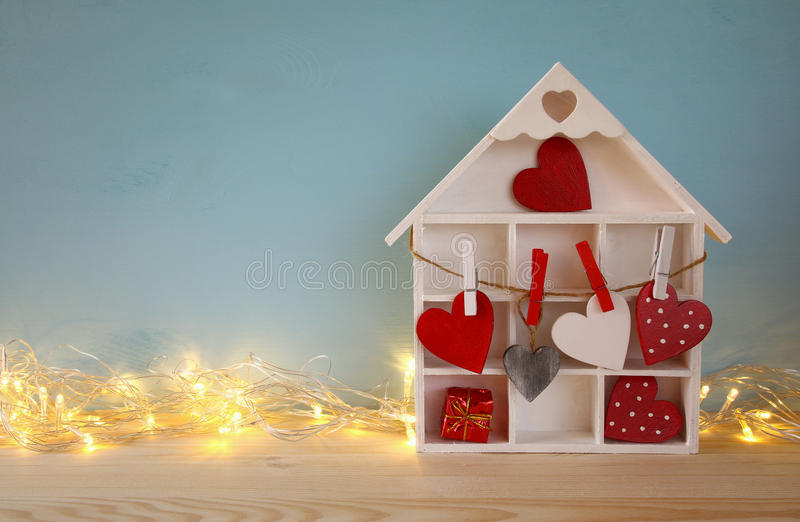 Download Wooden House With Many Hearts And Garland Lights Stock Photo - Image: 83701159