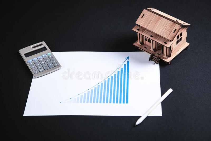 Wooden house model with calculator and pen royalty free stock image