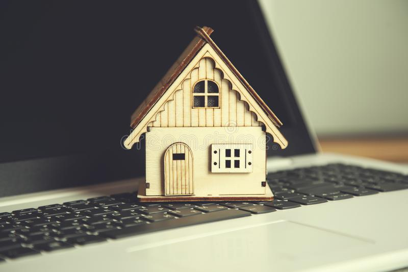 House model on keyboard. Wooden house model on the computer keyboard stock images