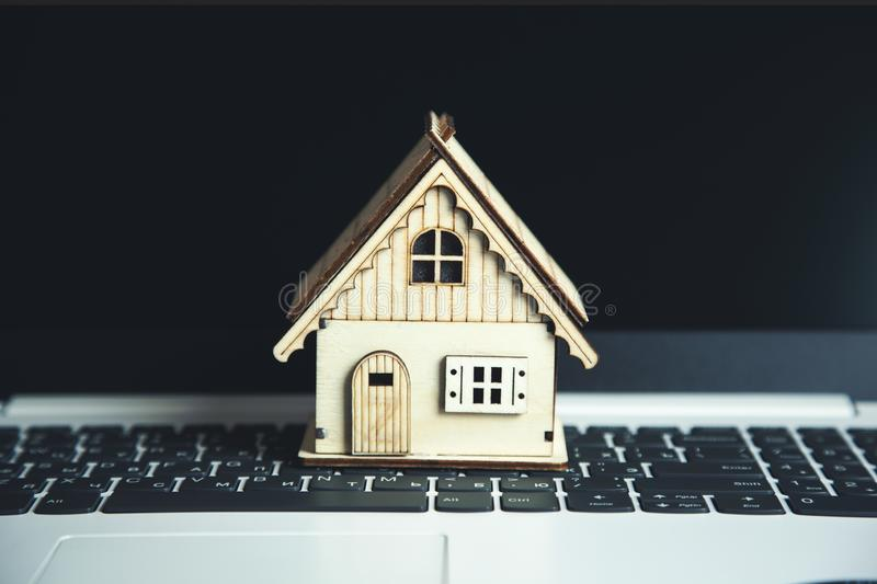 House model on keyboard. Wooden house model on the computer keyboard stock photography