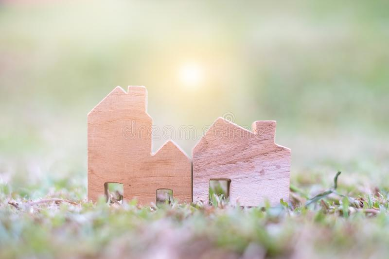 Wooden House Model on The ground. With copy space for text : Housing and Real Estate concept royalty free stock photography