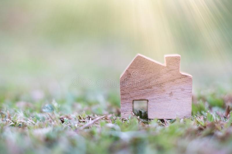 Wooden House Model on The ground. With copy space for text : Housing and Real Estate concept stock images