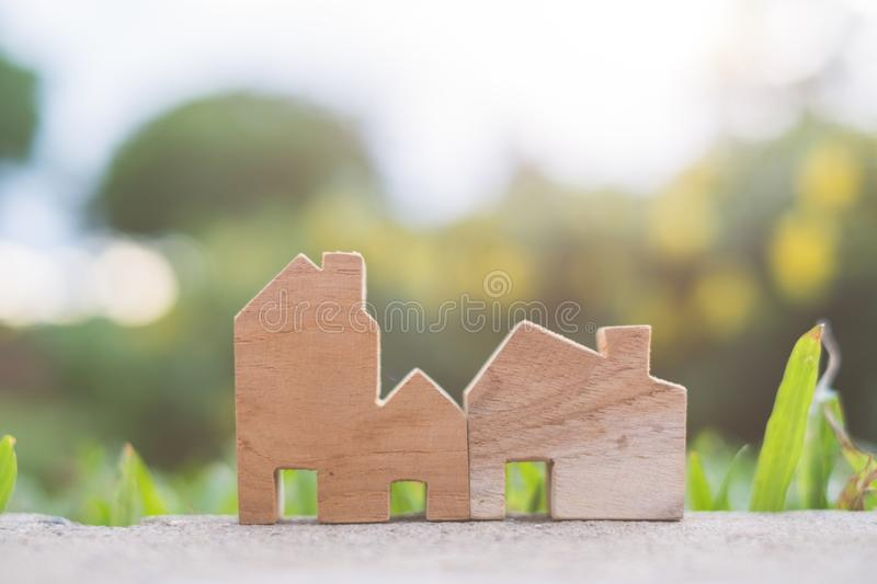 Wooden House Model on The ground. With copy space for text : Housing and Real Estate concept stock photos