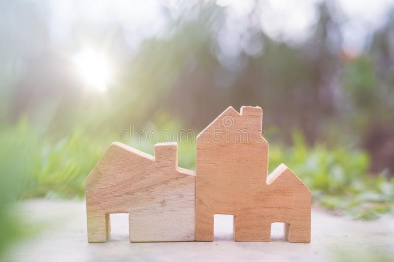 Wooden House Model on The ground. With copy space for text : Housing and Real Estate concept royalty free stock photos