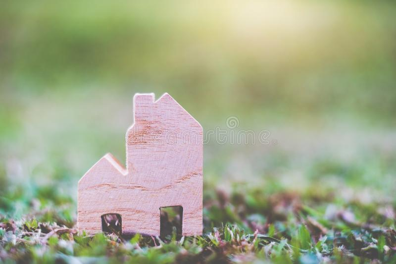 Wooden House Model on The ground. With copy space for text : Housing and Real Estate concept royalty free stock image