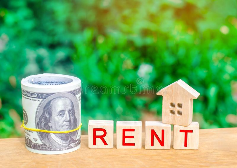 Wooden house, money with the inscription rent. Rental of property, apartments. services of a realtor. affordable housing, rental p royalty free stock image