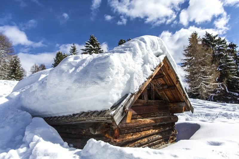 Wooden house in the mountains. Wooden house in winter forest. Winter vacation holiday wooden house in the mountains covered with s stock photos