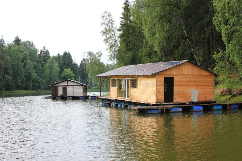A wooden house near the water. Summer. Relax on the river. Bathhouse. Istra. A wooden house near the water. Summer. Relax on the river. A Bathhouse an afloat royalty free stock photography