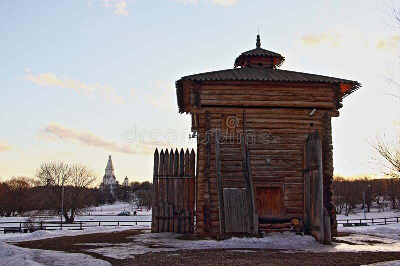 Wooden house, old Russian architecture in Moscow museum-reserve Kolomenskoye. Park on a winter day on snow background stock images