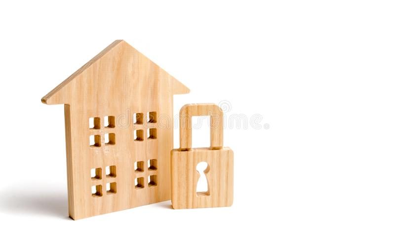 Wooden house padlock. The concept of protection of property and real estate, property rights. Installation of alarm systems and se royalty free stock photo