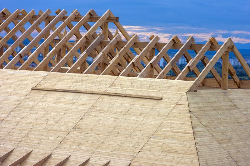 Wooden house roof frame under construction. royalty free stock image