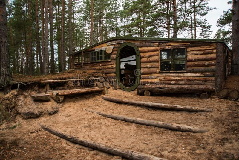 Wooden house with round door in the forest. Russia, Leningrad region, St. Petersburg royalty free stock photos