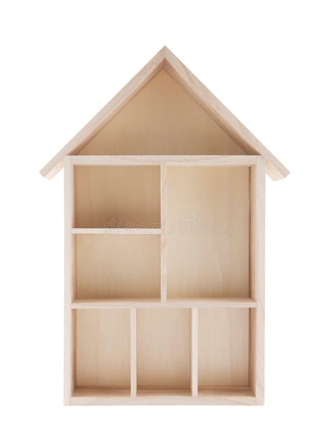 Wooden house shaped shelf. Isolated on white royalty free stock photo