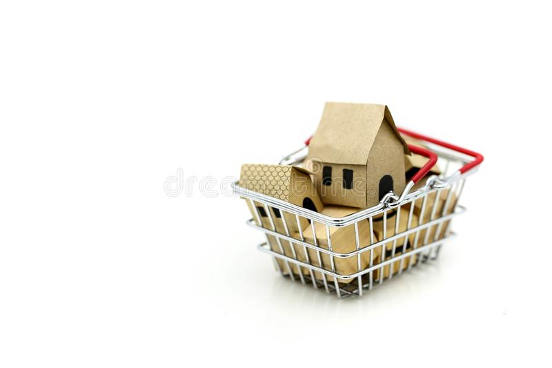 Wooden house in a shopping basket,Property investment and house royalty free stock image