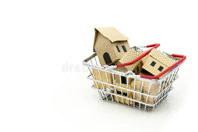 Wooden house in a shopping basket,Property investment and house stock image