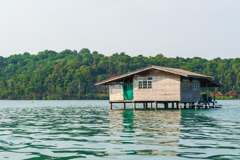 Wooden house on stilts. stock images