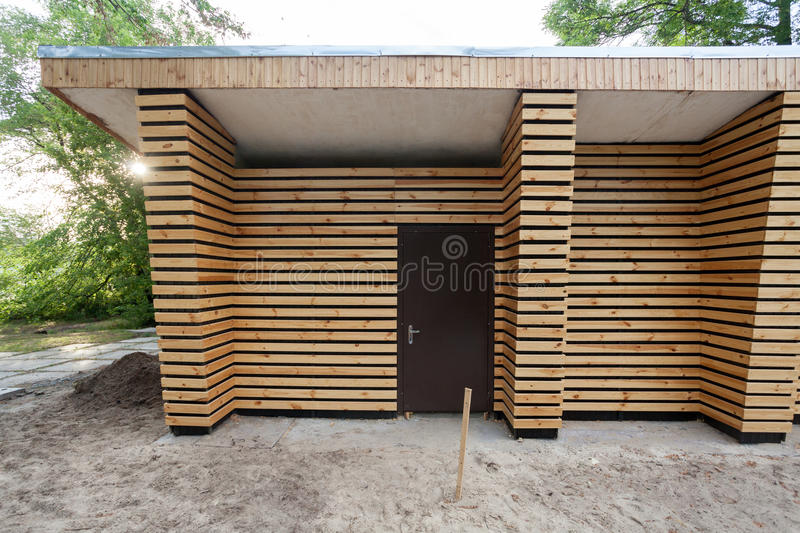 Wooden house for storage of garden tools royalty free stock photography