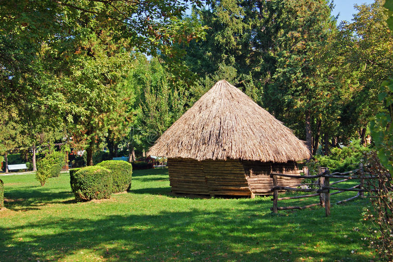 Wooden house in sunny garden royalty free stock photography