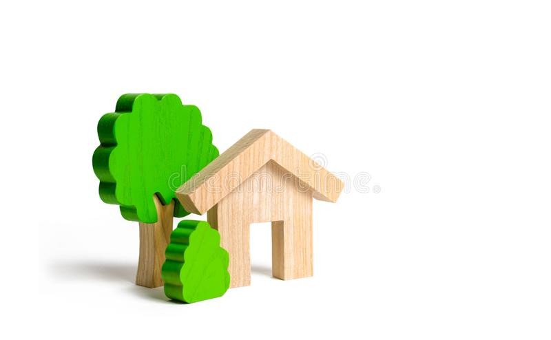 Wooden house and trees. Environmentally friendly and environmentally friendly home. Modern technology in construction. Quiet. And cozy, comfortable affordable stock images