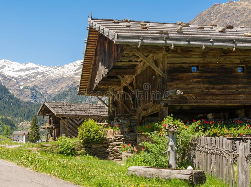 Wooden house typical in a alps village on Ridnaun Valley/Ridanna Valley - Racines country - near Sterzing/Vipiteno, South Tyrol, n. Orthern italy royalty free stock photos