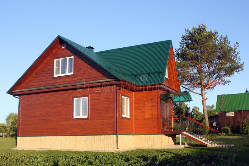 Red house with green metal roof