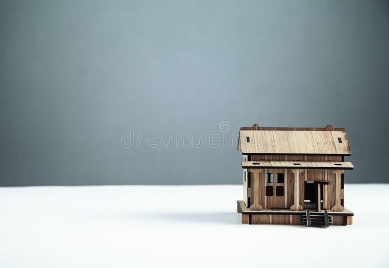 Wooden house on white desk stock images