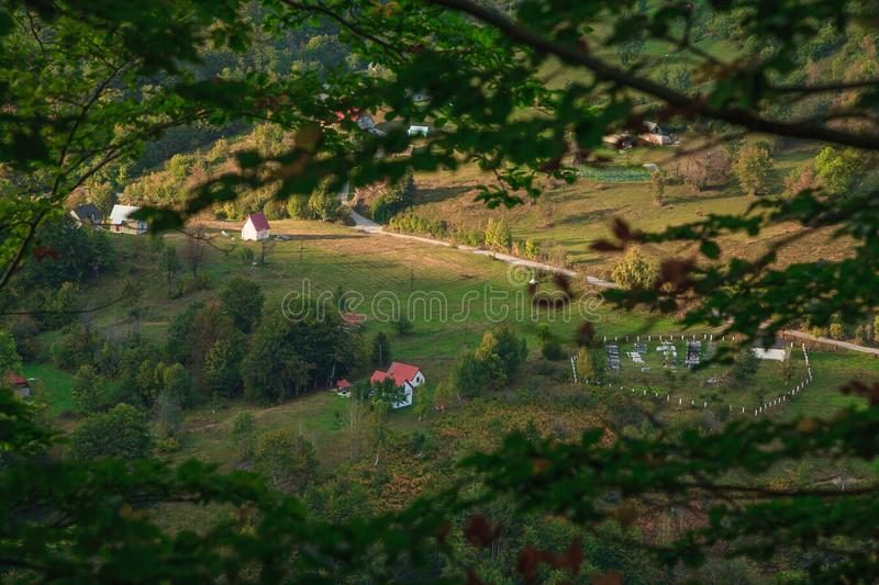 Wooden house in wild landscape stock photos