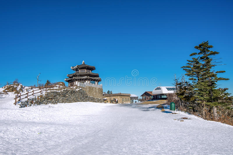 Wooden house in winter, Deogyusan mountains Korea. royalty free stock photography