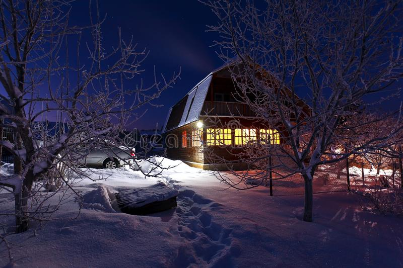 Wooden house in winter forest stock image