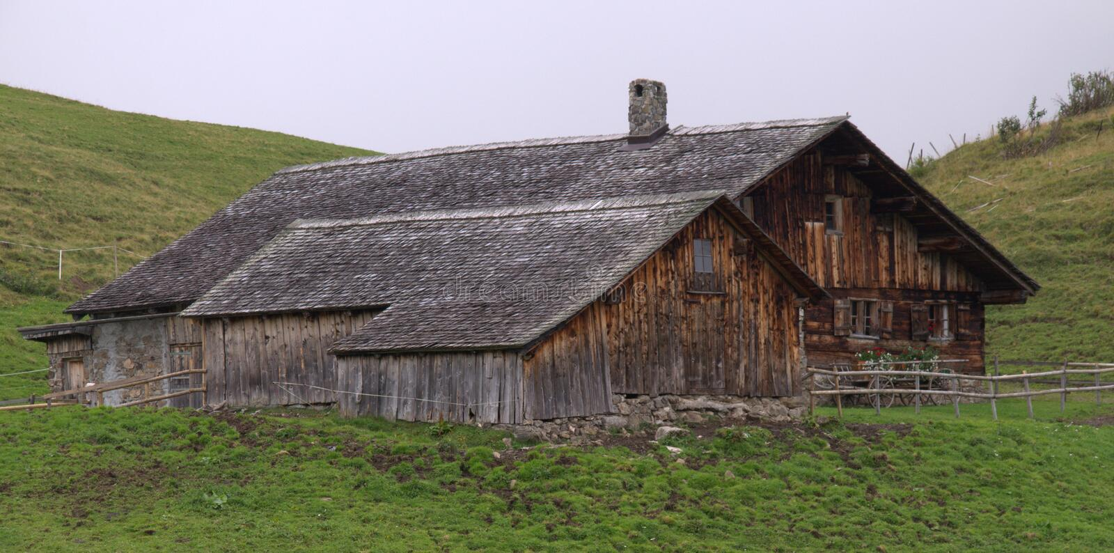 Wooden houses in the Alps. Rural wooden houses in the Alps royalty free stock photo