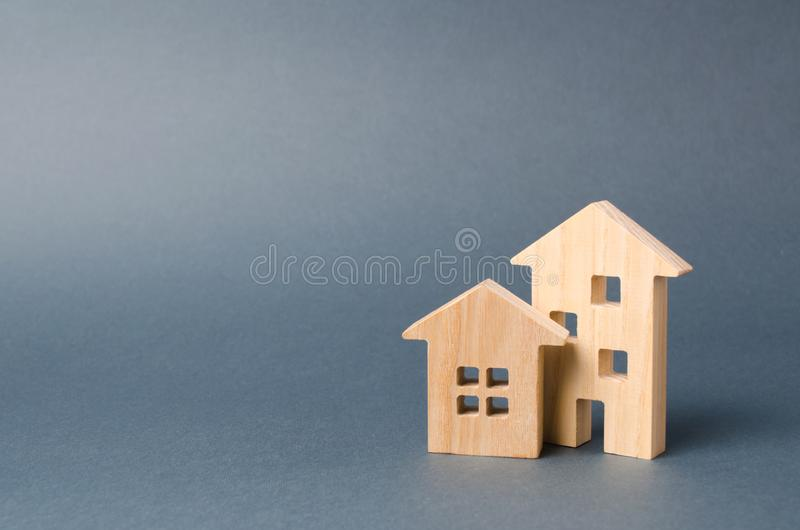 Wooden houses figures. Environmentally friendly and environmentally friendly home. Modern technology in construction. Quiet. And cozy, comfortable affordable royalty free stock image