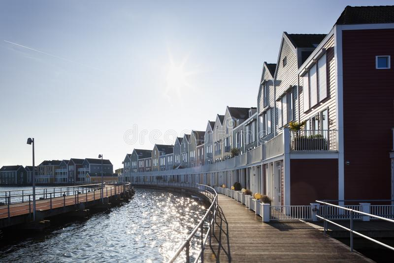 Wooden houses in Houten in the Netherlands. Wooden houses surrounded by water in Houten in the Netherlands stock image