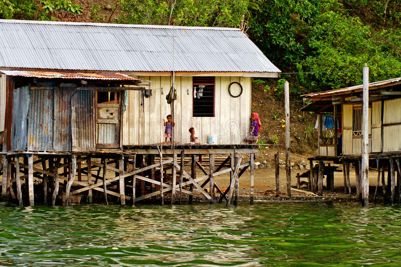 Wooden houses on lake Sentani, on New Guinea royalty free stock photo