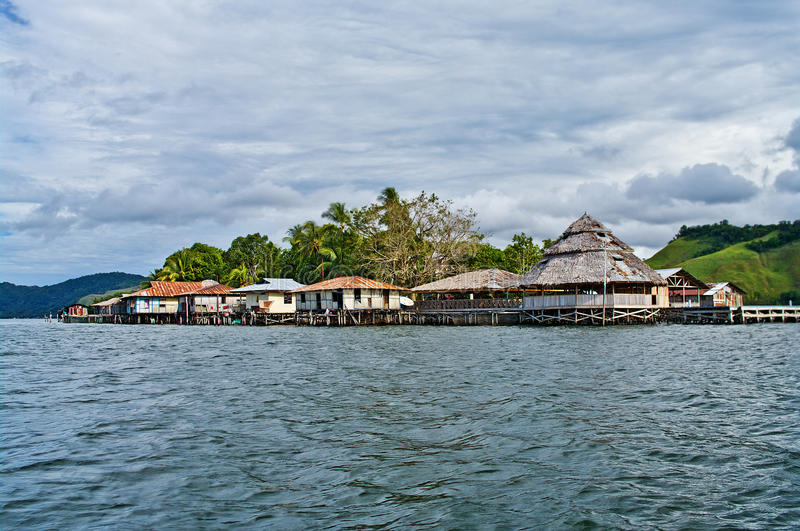 Wooden houses on lake Sentani, on New Guinea stock images