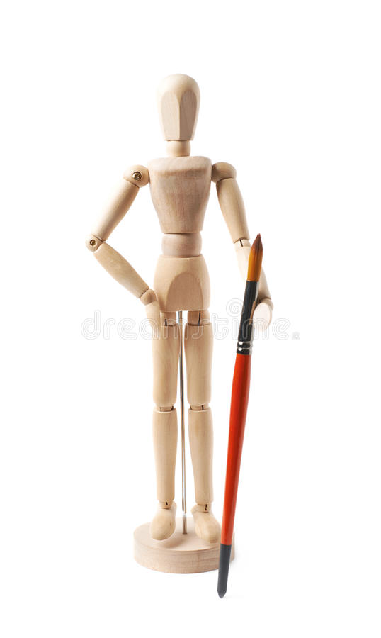 Wooden human statuette isolated. Wooden human statuette holding a drawing brush, composition isolated over the white background stock photo