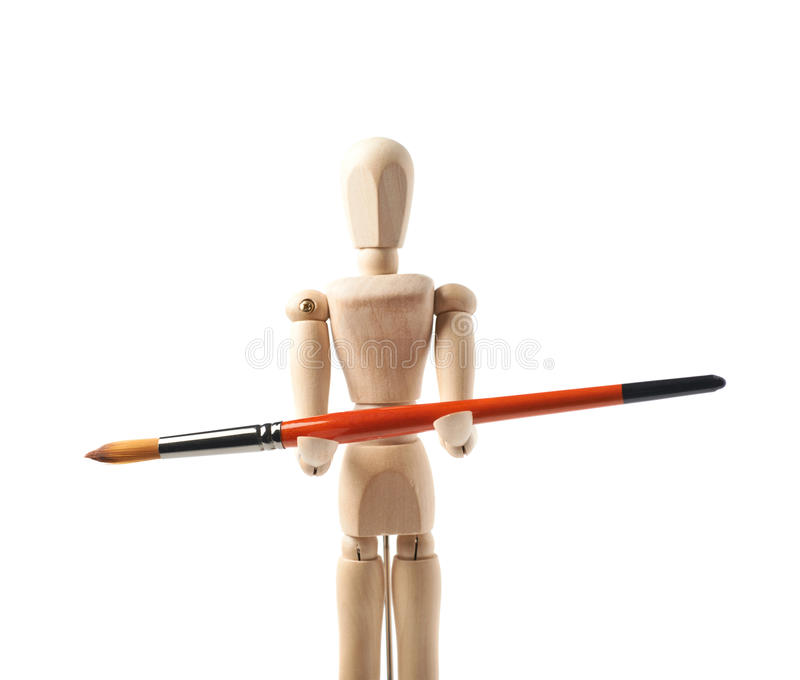 Wooden human statuette isolated. Wooden human statuette holding a drawing brush, composition isolated over the white background, close-up crop framgent royalty free stock photo