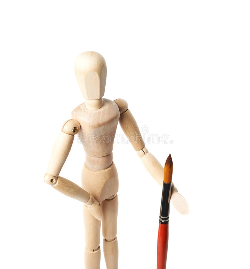 Wooden human statuette isolated. Wooden human statuette holding a drawing brush, composition isolated over the white background, close-up crop framgent stock image